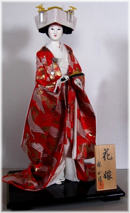 japanese traditional bride doll in wedding kimono and with