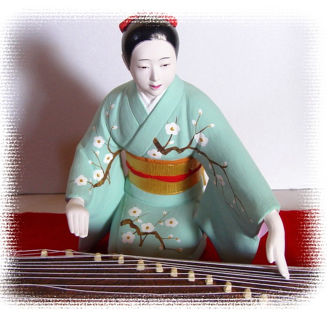 Young Lady Musician Playing Musical Instrument Koto